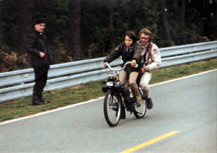 Steve Mac Queen with his son on a solex 3800