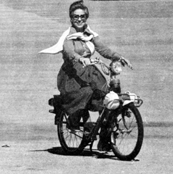 Woman on a solex 4600