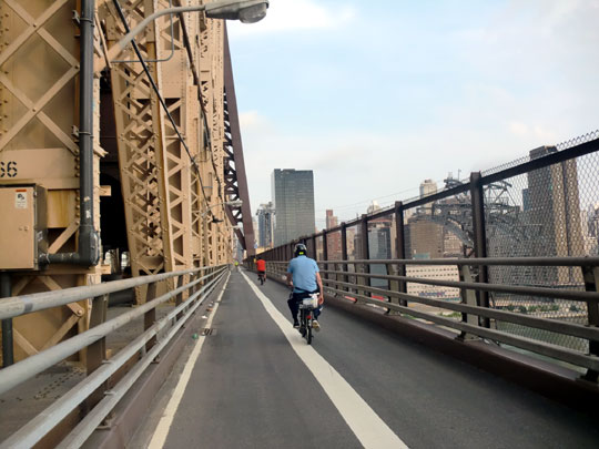 Crossing the queensborough bridge from long island to manhattan island